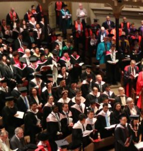 A photo of hundreds of graduates at the University of Divinity March 2018 ceremony, taken from above looking down, from the balcony of St Michael's Uniting church