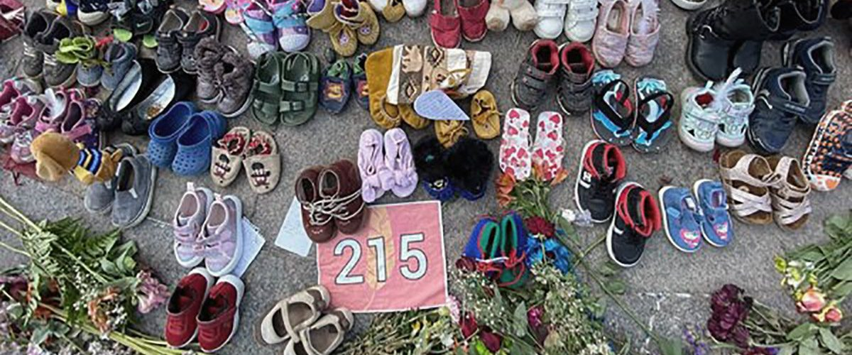 215 pairs of shoes to represent 215 children's graves at a former Indian Residential School in Canada