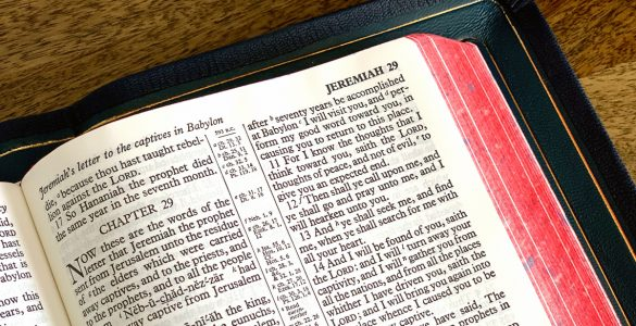 The Bible opened to the Book of Jeremiah outstretched on a table
