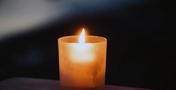 A single candle on a table