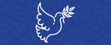 A dove in flight, carrying an olive branch